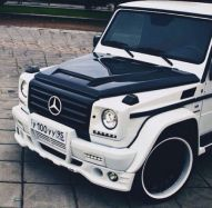 white and black Mercedes G wagon
